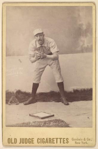 Doc_Bushong_in_1888_Old_Judge_baseball_card,_crouching_position
