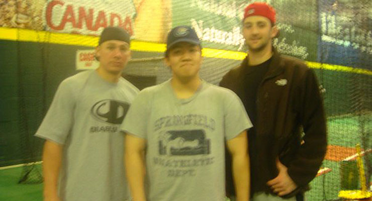 The author (center) poses with Nick Adenhart (right) and his bullpen catcher, two months before Adenhart's death. (via Sung-Min Kim)