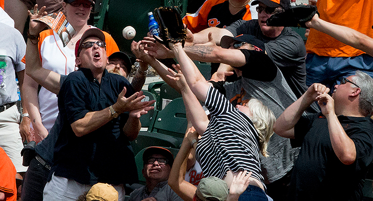 Just how badly do you want that foul ball, anyway? (via Keith Allison)