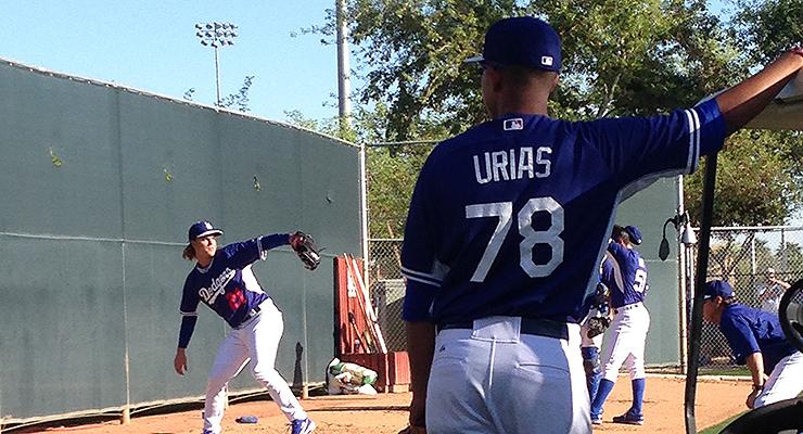 Non-roster invitee Julio Urias watches Zack Greinke during 2015 spring training. (via Stacie Wheeler)