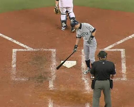 Ichiro Suzuki points where he thought the pitch was located.